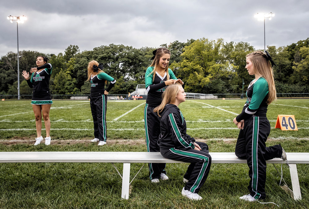 Athens freshman cheerleader Natalie Brown, center, helps to put braids in for fellow freshman Madison Reichert and Lainey Fricke, right, as they get ready to cheer on the Warriors as they take on Maroa-Forsyth in a football game at Athens High School, Friday, Sept. 30, 2016, in Athens, Ill. Justin L. Fowler/The State Journal-Register