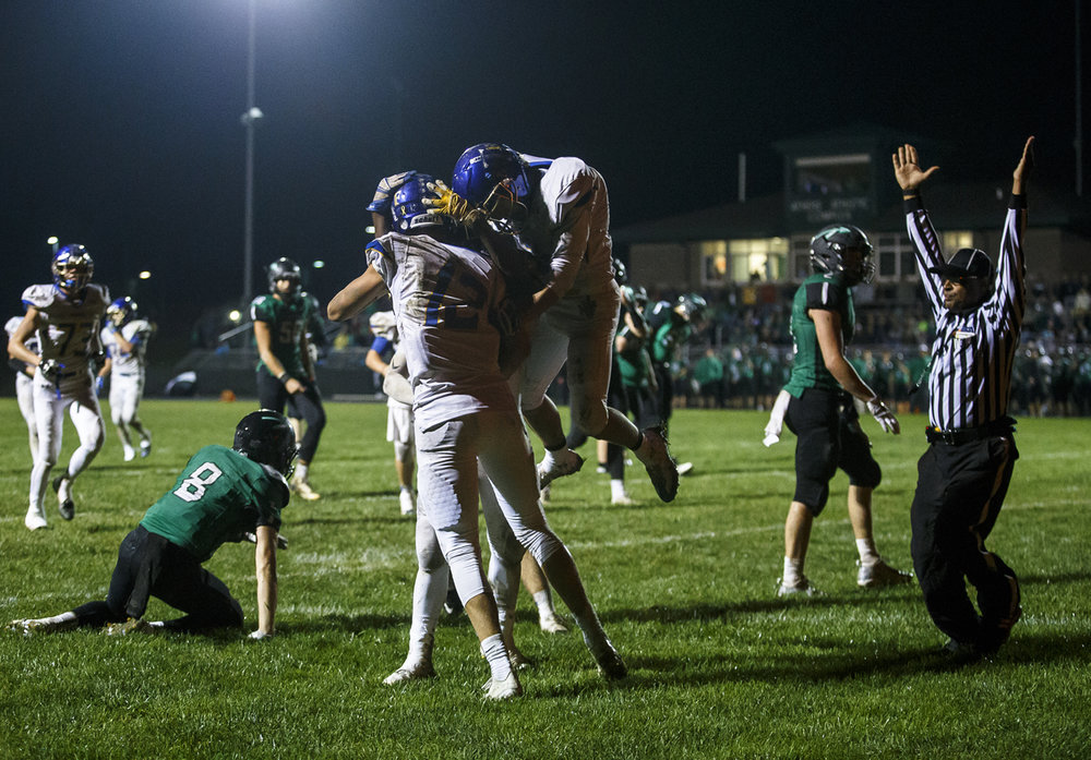 Maroa-Forsyth's Vedaant Patel (2) jumps up to celebrate a touchdown with Maroa-Forsyth's Grant Weis (12) against Athens' Mason Reiff (8) in the second half at Athens High School, Friday, Sept. 30, 2016, in Athens, Ill. Justin L. Fowler/The State Journal-Register