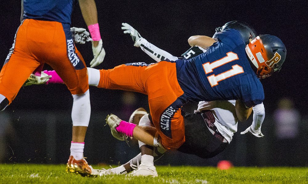 Rochester's Skylor Caruso tackles Decatur Eisenhower's Eric Thomas after he nearly intercepted a pass at Rochester High School Friday, Oct. 14, 2016. Ted Schurter/The State Journal-Register