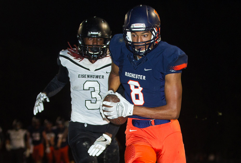 Rochester's Collin Stallworth hauls in a touhdown pass in front of Decatur Eisenhower's Stefon Jarrett at Rochester High School Friday, Oct. 14, 2016. Ted Schurter/The State Journal-Register