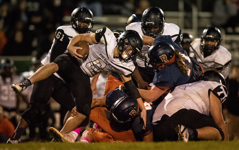 Decatur Eisenhower's Bryson Bonds goes around the pile as he tries to gain yards against Rochester at Rochester High School Friday, Oct. 14, 2016. Ted Schurter/The State Journal-Register