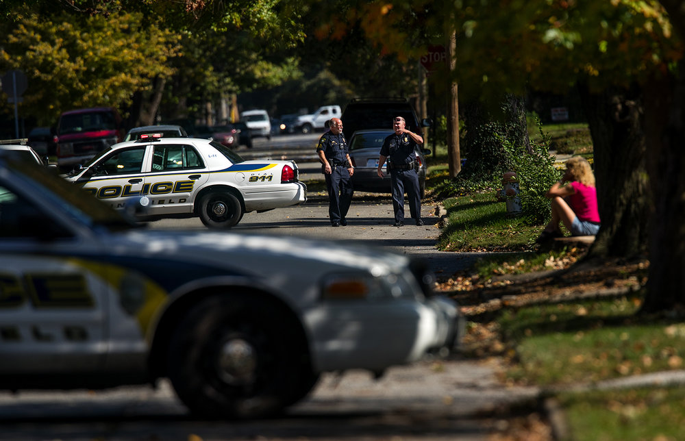 The Springfield Police Department cordoned off a half-block perimeter after a receiving a report of a suspicious device on the steps of a home in the 1200 block of West Edwards Saturday, Oct. 15, 2016.  The Illinois Secretary of State Bomb Squad retrieved the device safely. Ted Schurter/The State Journal-Register