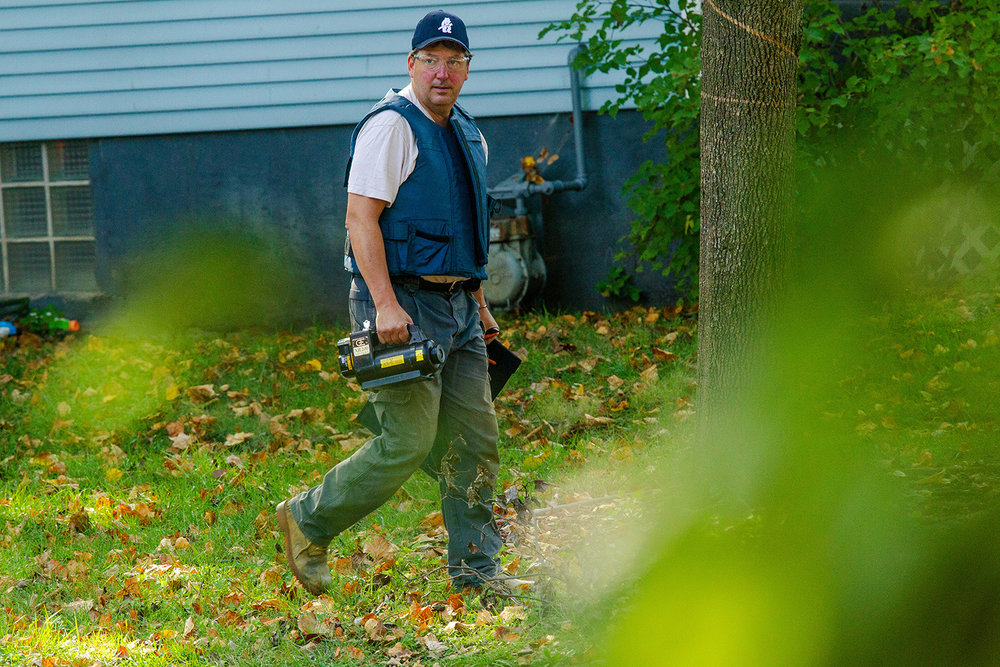 An Illinois Secretary of State Bomb Squad member carries a portable X-ray machine to to the front steps of a home on West Edwards Street to examine a suspected explosive device Saturday, Oct. 15, 2016. Ted Schurter/The State Journal-Register