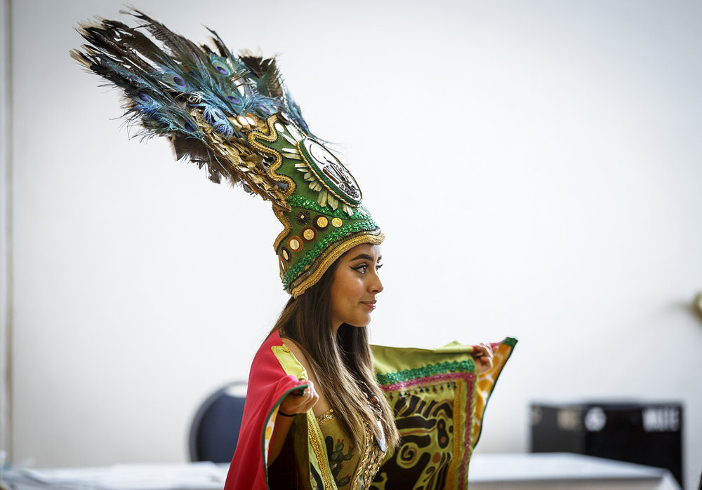 Karen Rangel, a sophomore at Beardstown High School, wears a traditional Aztec headdress in the opening parade during the Hispanic Heritage Family Festival to observe National Hispanic Heritage Month at the Kerasotes YMCA, Sunday, Oct. 2, 2016, in Springfield, Ill. Justin L. Fowler/The State Journal-Register