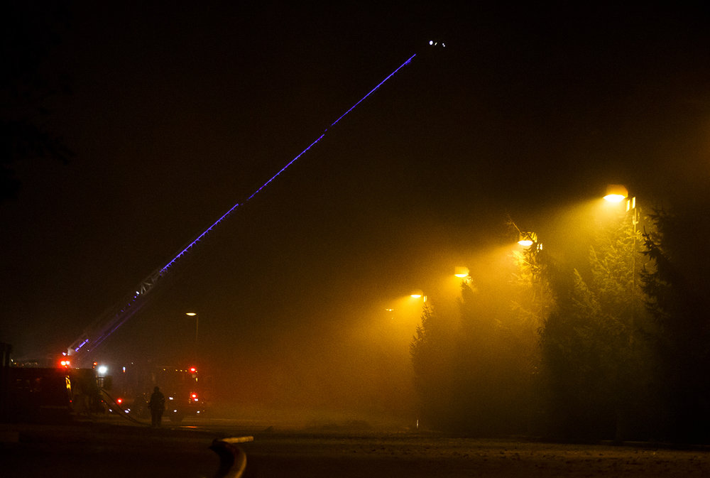 A ladder truck from Springfield Fire Department works over a row of trees on the scene of a fully engulfed barn fire south of Memorial Health System's Koke Mill Medical Center, Tuesday, Oct. 4, 2016, in Springfield, Ill. There were two horses in the barn at the time of the fire, firefighters were told, but both were able to get out safely. Justin L. Fowler/The State Journal-Register