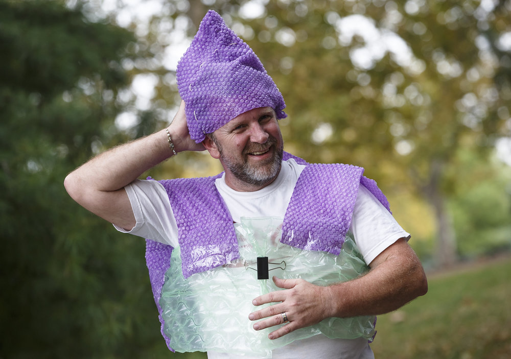"Thomas Gebhardt, a senior studying art and a custodian for UIS, built a life jacket and a captain's hat out of bubble wrap to wear as he took his bubble wrap boat across the UIS pond, Thursday, Oct. 6, 2016, in Springfield, Ill. Gebhardt had to pick a material and conduct experiments on it and build a sculpture using that as the primary structure. ""The maiden voyage was a little nervous, a little tiring getting the rowing,"" said Gebhardt. ""I got about three quarters across and I saw some water coming in, but all is good."" Justin L. Fowler/The State Journal-Register"