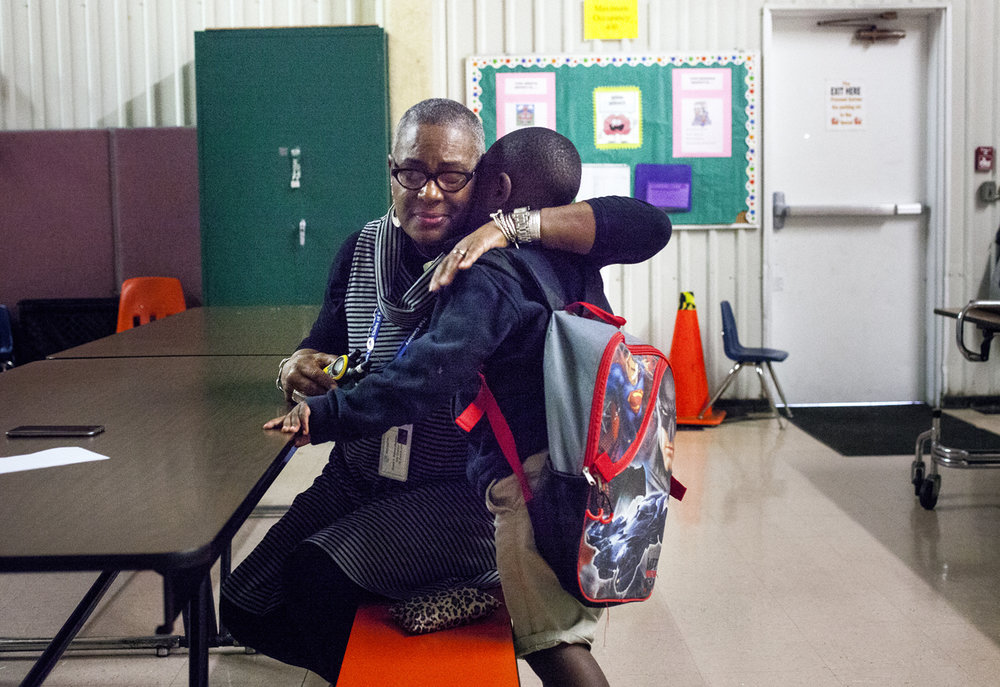 Sheila F. Wilson-Madden, site director of the Springfield Boy's and Girls Club's after school program at St. Patrick's School, embraces first grader Malakhi Washington when he entered the gymnasium Wednesday, Oct. 5, 2016. Rich Saal/The State Journal-Register