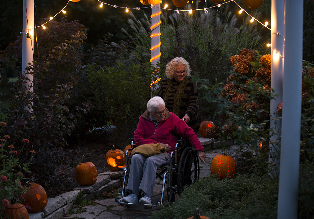 Sandra Hochreiter walks her mother, Leora Patkus, through a decorated garden pergola Friday, Oct. 14, 2016 at the the Jack-O-Lantern Spectacular in Washington Park. More than 2000 candle-lit jack-o-lanterns were displayed around the botanical garden.The event continues again this evening 6:30 PM - 9:30 PM. Rich Saal/The State Journal-Register