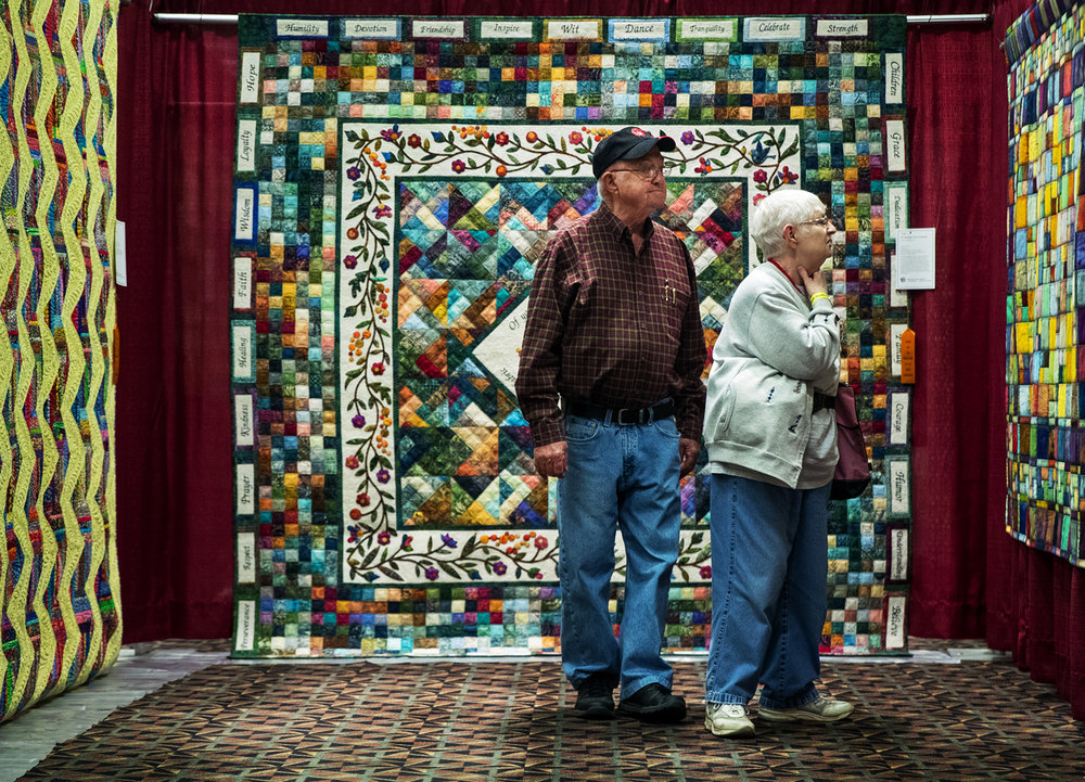 Gib and Sandra Miget of Herculaneum, MO inspect the quilts on display at the MQX Quilt Festival 2016 at the Crowne Plaza Thursday, Oct. 20, 2016. The show features educational classes, quilt displays and a vendor hall with materials and tools and is open through Sunday. Ted Schurter/The State Journal-Register