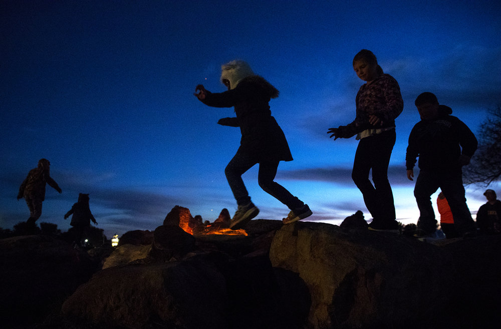 Children leap from rock to rock around a fire pit as they wait for the gates to open at the Carter Brothers Haunted Hayride Friday, Oct. 21, 2016. Ted Schurter/The State Journal-Register