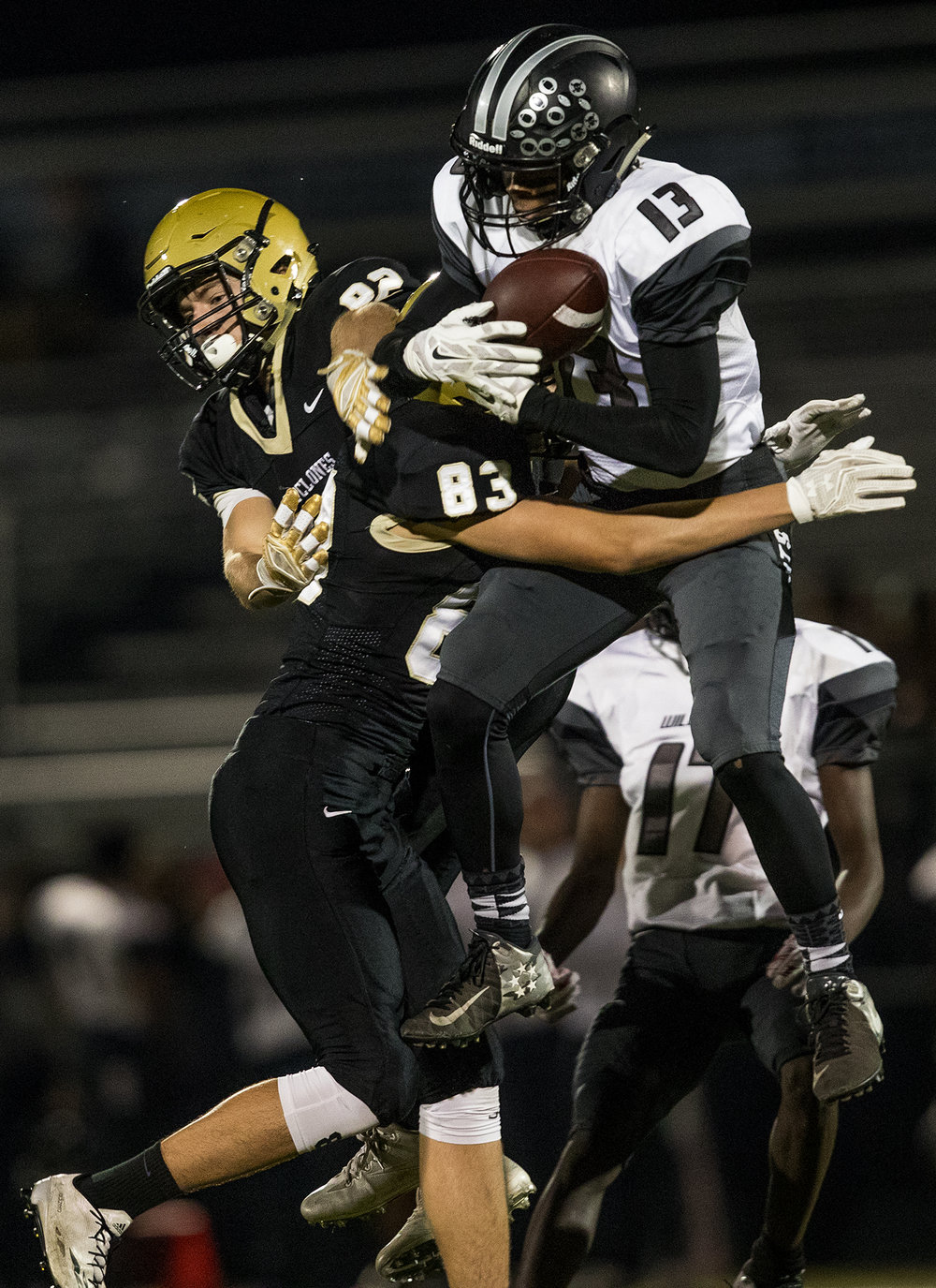 Normal West's Isaiah Shifflett picks off an interception in front of Sacred Heart-Griffin's Vince Mounce during the Class 6A playoff game at the SHG athletic complex Friday, Oct. 28, 2016. Ted Schurter/The State Journal-Register