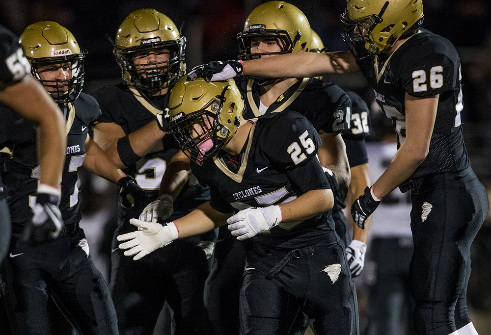 Sacred Heart-Griffin's Joey Milbrandt's teammates congratulate him after a tackle on a kick off against Normal West during the Class 6A playoff game at the SHG athletic complex Friday, Oct. 28, 2016. Ted Schurter/The State Journal-Register