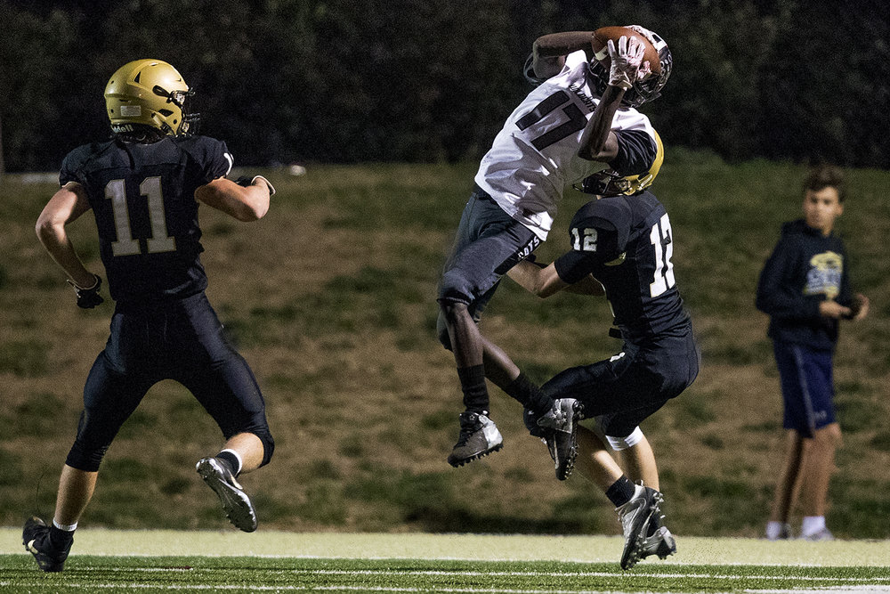 Normal West's Armani Forrest grabs a reception in the third quarter in front of Sacred Heart-Griffin's Sam Raes during the Class 6A playoff game at the SHG athletic complex Friday, Oct. 28, 2016. Ted Schurter/The State Journal-Register