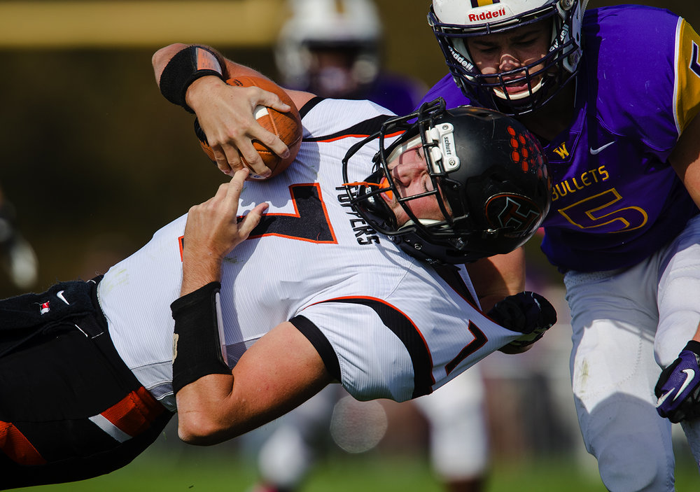 Williamsville's Zach Dellert yanks Hillsboro quarterback Mitchell Reynolds to the ground during the class 3A football playoffs at Williamsville High School Saturday, Oct. 28, 2016. Ted Schurter/The State Journal-Register