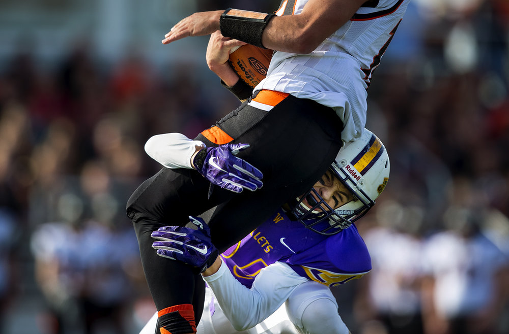 Williamsville's Patrick Hegland crashes into the legs of Hillsboro's Johnathan McCaslin during the class 3A football playoffs at Williamsville High School Saturday, Oct. 28, 2016. Ted Schurter/The State Journal-Register