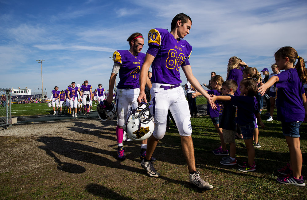 Williamsville's Joseph Mitchell (4) and Hunter Gold (80) are congratulated by fans after they defeated Hillsboro during the class 3A football playoffs at Williamsville High School Saturday, Oct. 28, 2016. Ted Schurter/The State Journal-Register