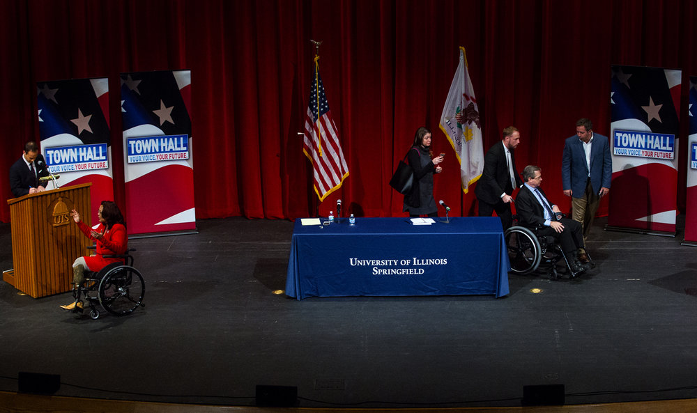U.S. Rep. Tammy Duckworth, D-Hoffman Estates, left, and U.S. Sen. Mark Kirk, R-Ill., head to different corners of the stage to visit with the crowd during a break in their debate at Sangamon Auditorium Thursday, Oct. 27, 2016. Ted Schurter/The State Journal-Register