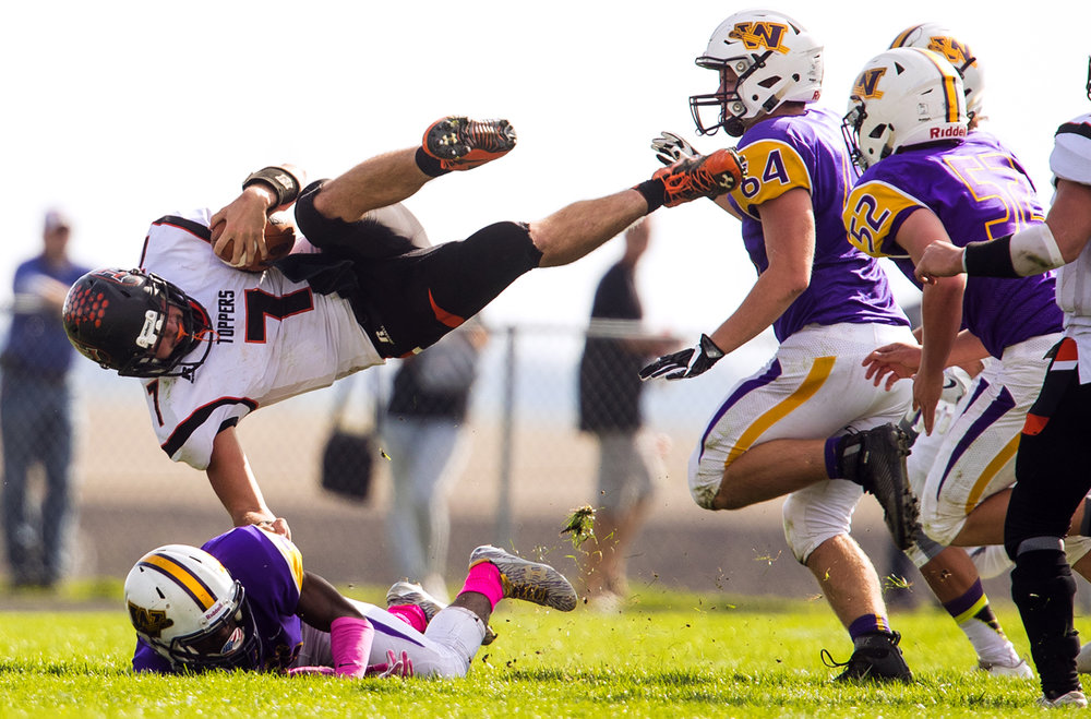 Hillsboro's Mitchell Reynolds is upended by Williamsville's Daetayvian Woodson during the class 3A football playoffs at Williamsville High School Saturday, Oct. 28, 2016. Ted Schurter/The State Journal-Register