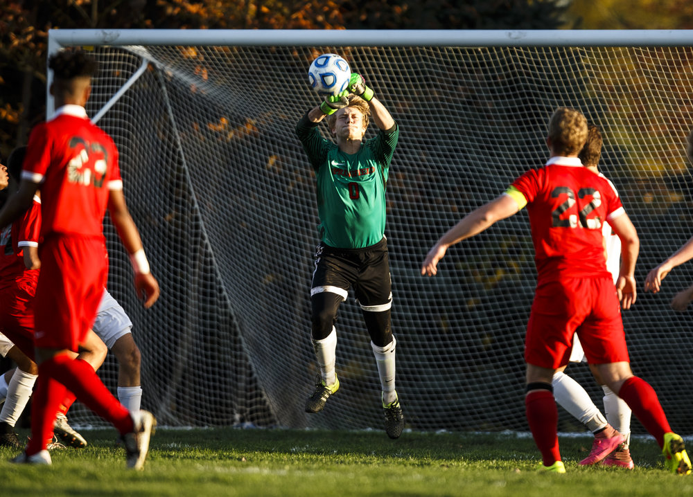Springfield's goal keeper Evan Wright (0) punches a ball out from in front of the goal against Jacksonville in the first half during the IHSA Class 2A Springfield Supersectional at the University of Illinois Springfield, Tuesday, Nov. 1, 2016, in Springfield, Ill. Justin L. Fowler/The State Journal-Register