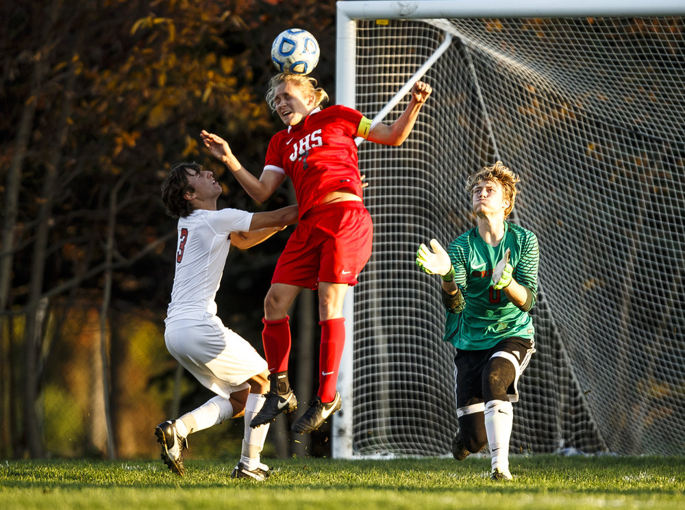 Jacksonville's Nash Oldenettel (7) smacks a header into the goal against Springfield's goal keeper Evan Wright (0) and Springfield's Luke Owsley (3) to put the Crimsons up 1-0 against Springfield in the first half during the IHSA Class 2A Springfield Supersectional at the University of Illinois Springfield, Tuesday, Nov. 1, 2016, in Springfield, Ill. Justin L. Fowler/The State Journal-Register