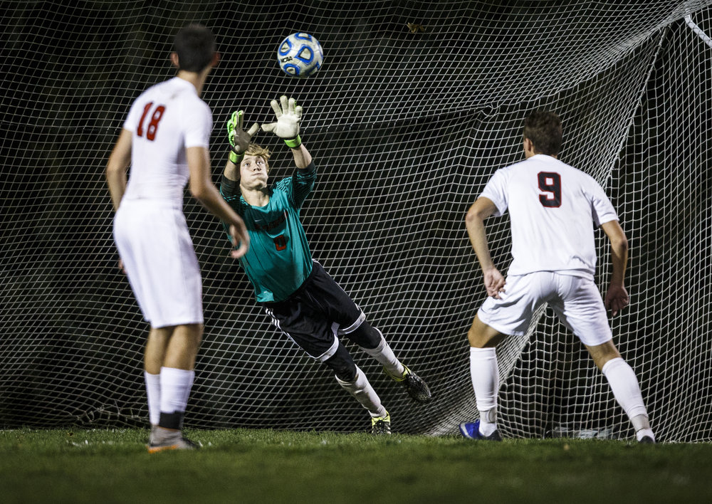 Springfield's goal keeper Evan Wright (0) makes a diving save against Jacksonville in overtime during the IHSA Class 2A Springfield Supersectional at the University of Illinois Springfield, Tuesday, Nov. 1, 2016, in Springfield, Ill. Justin L. Fowler/The State Journal-Register