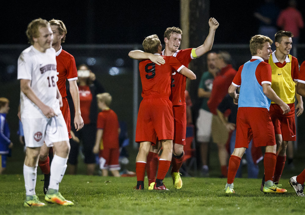 Jacksonville's Steven Albers (22) and Jacksonville's Ben Leutz (9) celebrate after the Crimsons defeated Springfield 3-2 in overtime during the IHSA Class 2A Springfield Supersectional at the University of Illinois Springfield, Tuesday, Nov. 1, 2016, in Springfield, Ill. Justin L. Fowler/The State Journal-Register