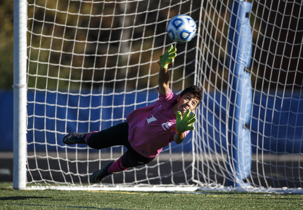 Chicago Mt. Carmel goal keeper Sergio Valencia (1) is unable to stop a penalty pick from Jacksonville during the semifinals of the IHSA Class 2A State Final Tournament at Hoffman Estates High School, Friday, Nov. 4, 2016, in Hoffman Estates, Ill. Justin L. Fowler/The State Journal-Register