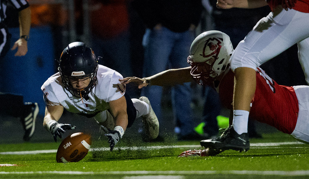 Rochester's Skylor Caruso dives to recover a Mt. Zion fumble during the Class 4A playoff game at Mt. Zion Friday, Nov. 4, 2016. Ted Schurter/The State Journal-Register