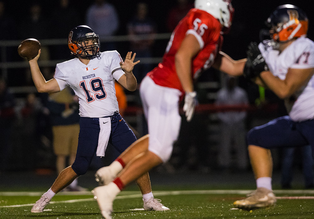 Rochester's Nic Baker fires a touchdown pass to Collin Stallworth against Mt. Zion during the Class 4A playoff game at Mt. Zion Friday, Nov. 4, 2016. Ted Schurter/The State Journal-Register