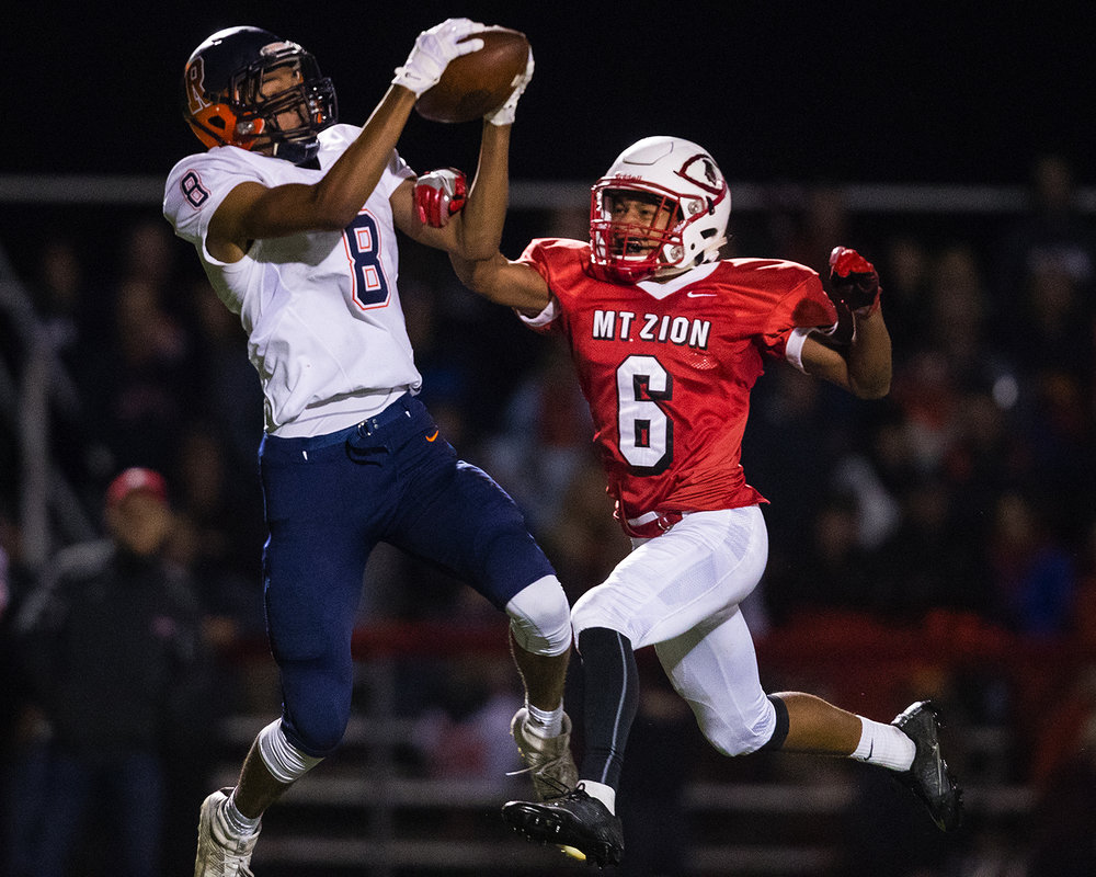 Rochester's Collin Stallworth grabs a touchdown pass in front of Mt. Zion's Nick Auton during the Class 4A playoff game at Mt. Zion Friday, Nov. 4, 2016. Ted Schurter/The State Journal-Register
