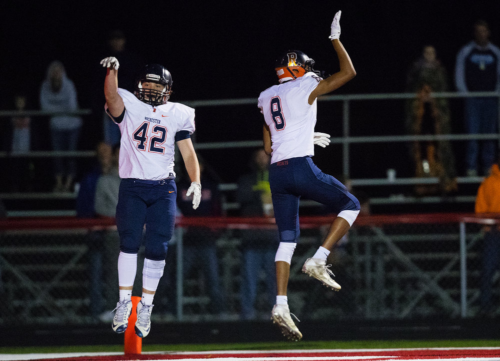 Rochester's Sam Baker, left, and Collin Stallworth celebrate a touchdown aganst Mt. Zion during the Class 4A playoff game at Mt. Zion Friday, Nov. 4, 2016. Ted Schurter/The State Journal-Register
