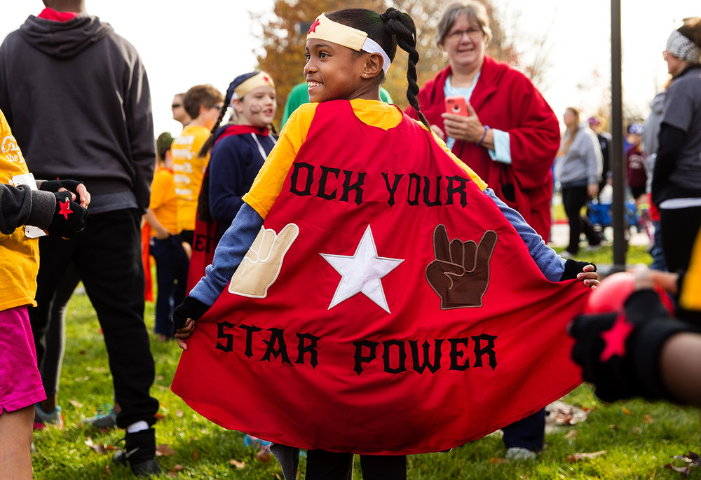 "Jordan Borders smiles as she models her cape before the Girls on the Run ""Be Your Own Super Hero"" 5k on the campus of Lincoln Land Community College Saturday, Nov. 5, 2016. The run is the culmination of a 10-week program which focuses on teaching self-respect and healthy lifestyle choices. Ted Schurter/The State Journal-Register"
