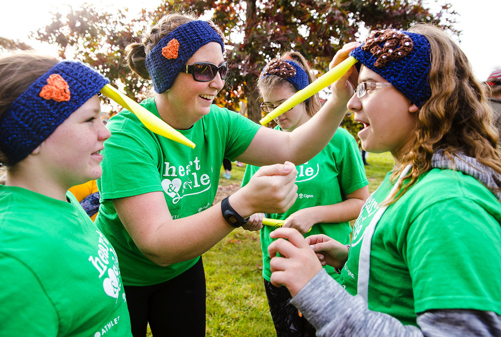 "Megan Yarko adjusts a pretzel ""horn underneath Brandi Spann headband before the Girls on the Run ""Be Your Own Super Hero"" 5k on the campus of Lincoln Land Community College Saturday, Nov. 5, 2016. The New Berlin Junior High School team deemed themselves the ""Pretzelcorns."" The run is the culmination of a 10-week program which focuses on teaching self-respect and healthy lifestyle choices. Ted Schurter/The State Journal-Register"