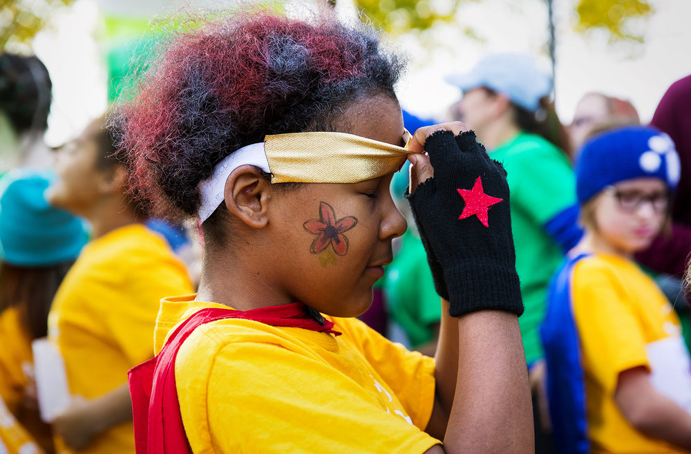 "Harmony Mathews adjusts her superpower headband before the Girls on the Run ""Be Your Own Super Hero"" 5k on the campus of Lincoln Land Community College Saturday, Nov. 5, 2016. The run is the culmination of a 10-week program which focuses on teaching self-respect and healthy lifestyle choices. Ted Schurter/The State Journal-Register"