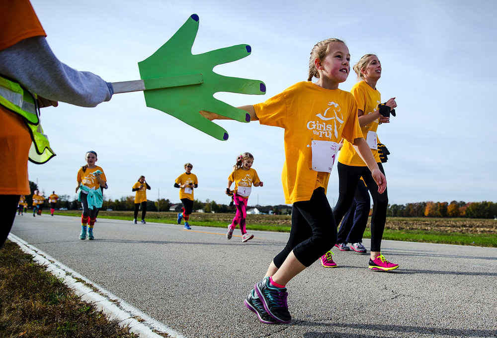 "Volunteers along the course encouraged runners with high fives, water and encouragement during the Girls on the Run ""Be Your Own Super Hero"" 5k on the campus of Lincoln Land Community College Saturday, Nov. 5, 2016. The run is the culmination of a 10-week program which focuses on teaching self-respect and healthy lifestyle choices. Ted Schurter/The State Journal-Register"