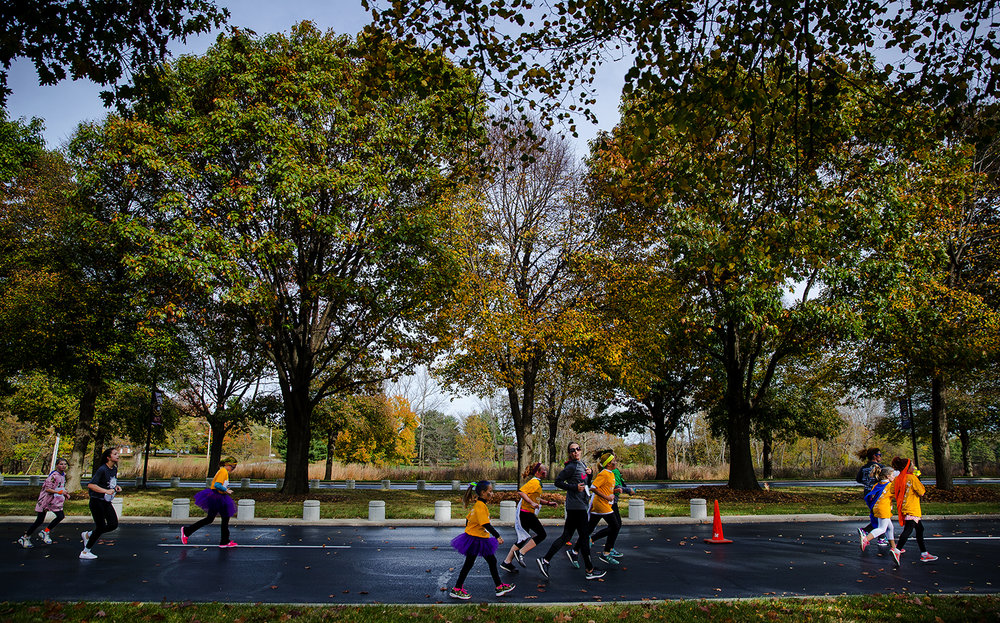 "Runners make their way across the course during the Girls on the Run ""Be Your Own Super Hero"" 5k on the campus of Lincoln Land Community College Saturday, Nov. 5, 2016. The run is the culmination of a 10-week program which focuses on teaching self-respect and healthy lifestyle choices. Ted Schurter/The State Journal-Register"