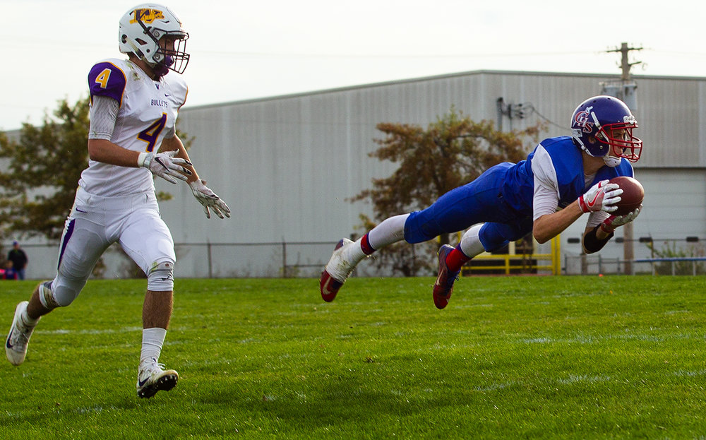 Carlinville's Kyle Dixon makes a diving interception against Williamsville during the class 3A football playoffs at Carlinville High School Saturday, Nov. 5, 2016. Ted Schurter/The State Journal-Register
