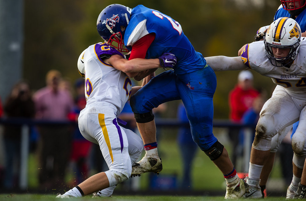 Carlinville's Jacob Dixon plows into Williamsville's Patrick Hegland and into the endzone for one of hs during the class 3A football playoffs at Carlinville High School Saturday, Nov. 5, 2016. Dixon carried 32 times for 250 yards and four touchdowns. Ted Schurter/The State Journal-Register