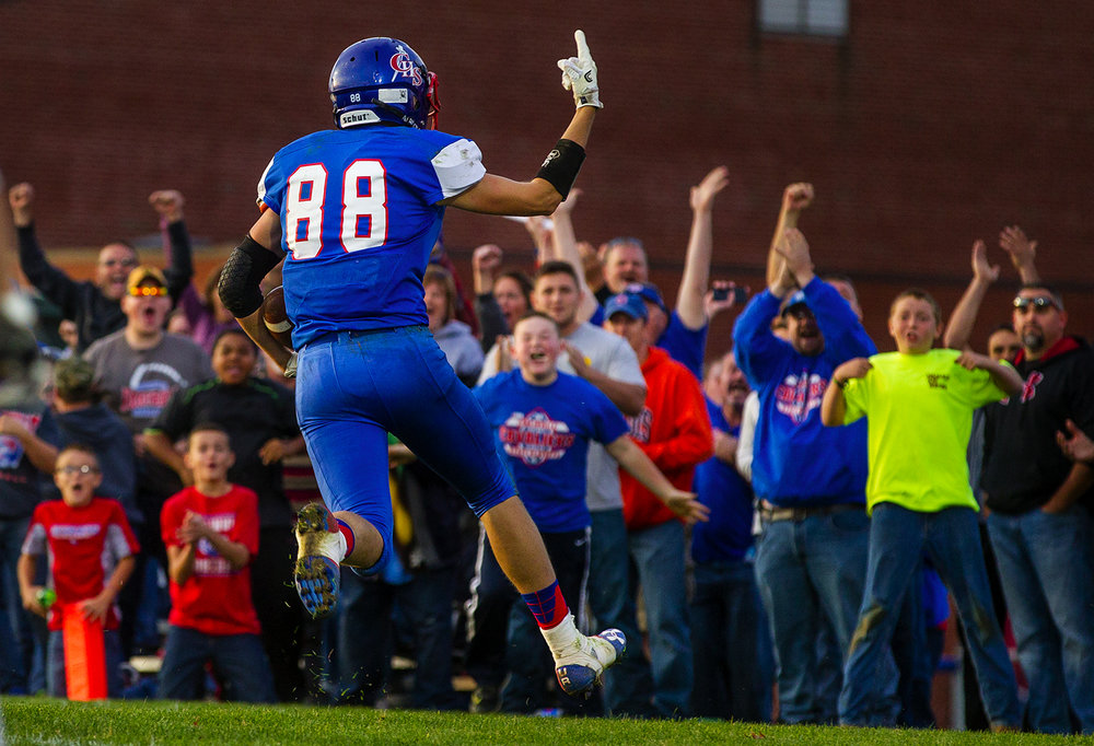 Carlinville's Brady Jamieson celebrates after hauling in a 46-yard touchdown and the decisive score with 1 minute 56 seconds left in Carlinville's 46-35 win over Williamsville in their second-round Class 3A football playoff game. Ted Schurter/The State Journal-Register