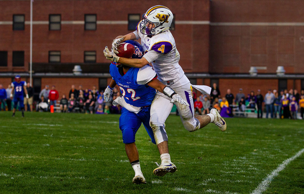 Williamsville's Joseph Mitchell catches a pass over Carlinville's  Donovan King with 2.4 seconds left during the class 3A football playoffs at Carlinville High School Saturday, Nov. 5, 2016. The Bullets hail marry pass on the final play was batted down and Carlinville won 42-35. Ted Schurter/The State Journal-Register