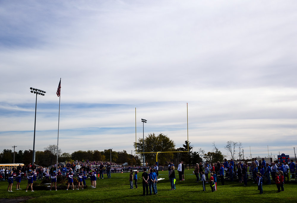The crowd stands for the national anthem before Williamsville faces Carlinville in the class 3A football playoffs at Carlinville High School Saturday, Nov. 5, 2016. Ted Schurter/The State Journal-Register