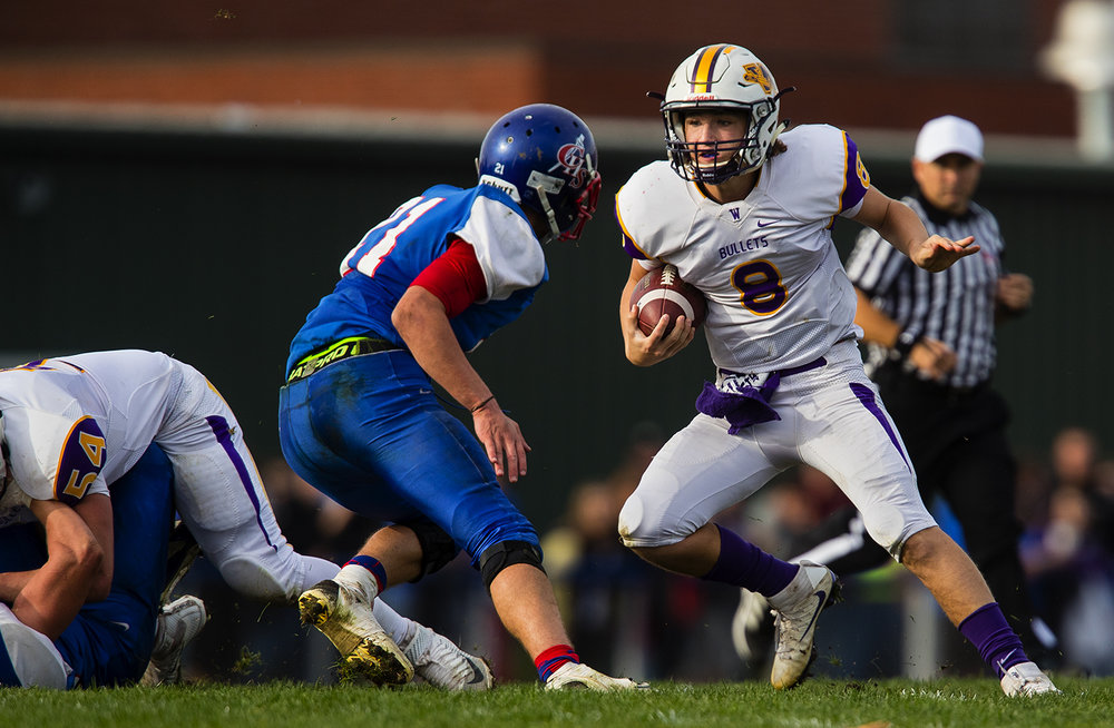 Williamsville quarterback Justice Ferrier runs the ball upfield against Carlinville during the class 3A football playoffs at Carlinville High School Saturday, Nov. 5, 2016. Ted Schurter/The State Journal-Register