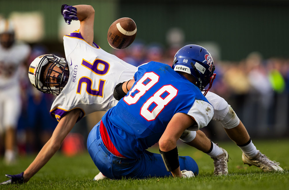 Williamsville's Patrick Hegland forces a fumble from Carlinville's Brady Jamieson during the class 3A football playoffs at Carlinville High School Saturday, Nov. 5, 2016. Ted Schurter/The State Journal-Register