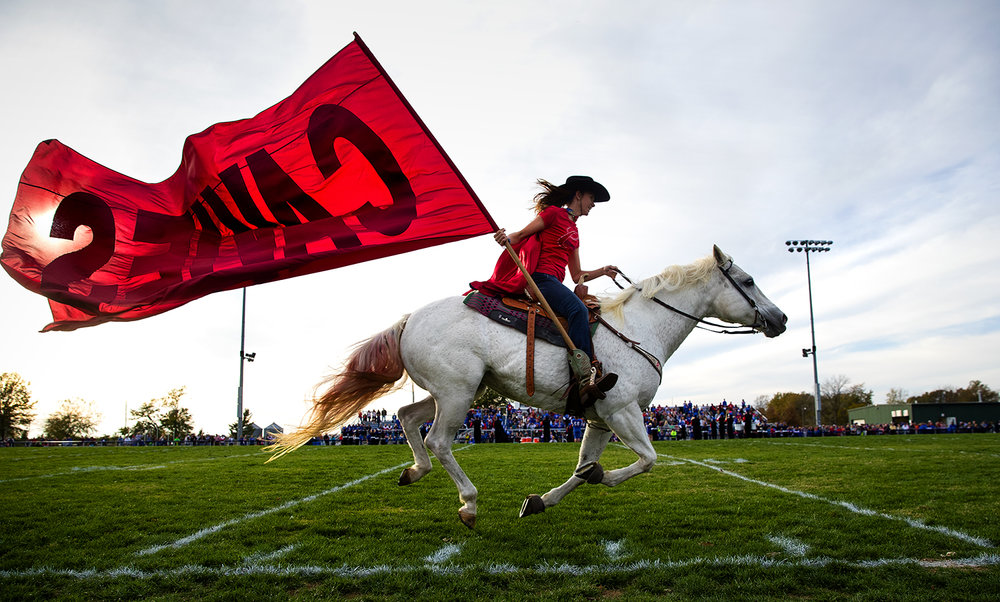 Sydney Leonard rides her horse Nova while waving the Carlinville High School flag during halftime of the class 3A football playoffs at Carlinville High School Saturday, Nov. 5, 2016. Ted Schurter/The State Journal-Register