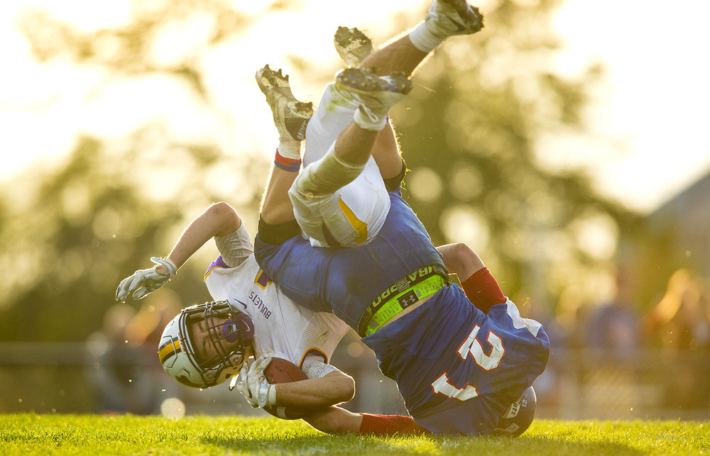 Williamsville's Joseph Mitchell and Carlinville's Jacob Dixon crash to the ground after Mitchell's pass reception during the class 3A football playoffs at Carlinville High School Saturday, Nov. 5, 2016. Ted Schurter/The State Journal-Register