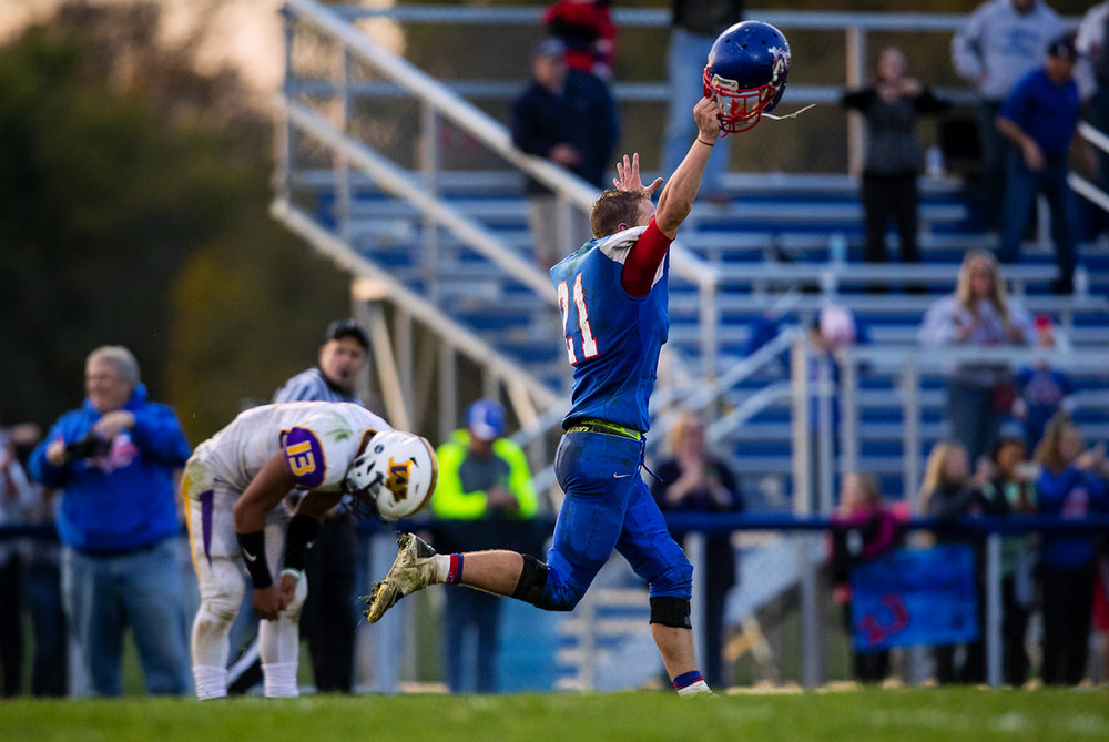 Carlinville's Jacob Dixon sprints toward his teammates after batting down a final Williamsville pass attemp with 2.4 seconds left in the game to give the Cavliers a 42-45 win during the class 3A football playoffs at Carlinville High School Saturday, Nov. 5, 2016. Ted Schurter/The State Journal-Register