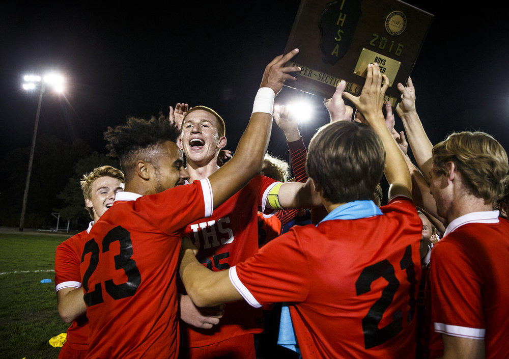 Jacksonville's Brandon McCombs (35) and the Crimsons celebrate their 3-2 victory over Springfield to win the IHSA Class 2A Springfield Supersectional at the University of Illinois Springfield, Tuesday, Nov. 1, 2016, in Springfield, Ill. Justin L. Fowler/The State Journal-Register