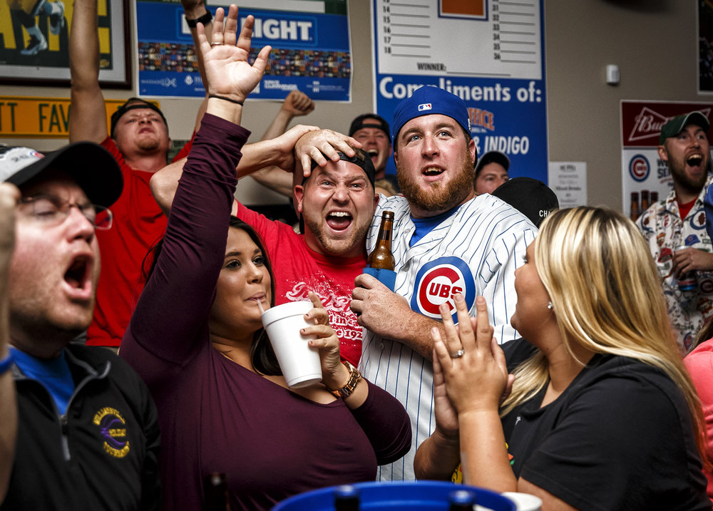 Chris Anderson, right, and Artie Nolan, left, celebrate with their fellow Chicago Cubs fans as the team takes a 4-1 lead against the Cleveland Indians while watching Game 7 of the 2016 World Series at The Office Sports Bar & Grill, Wednesday, Nov. 2, 2016, in Springfield, Ill. Justin L. Fowler/The State Journal-Register