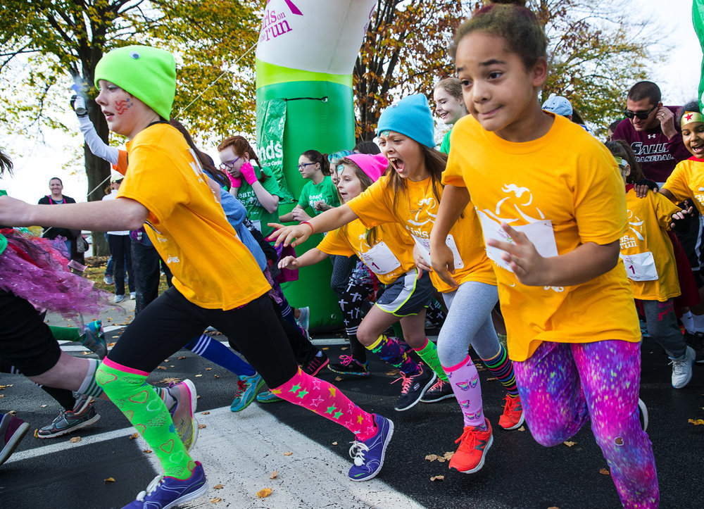 "Girls sprint from the starting line during the Girls on the Run ""Be Your Own Super Hero"" 5k on the campus of Lincoln Land Community College Saturday, Nov. 5, 2016. The run is the culmination of a 10-week program which focuses on teaching self-respect and healthy lifestyle choices. Ted Schurter/The State Journal-Register"