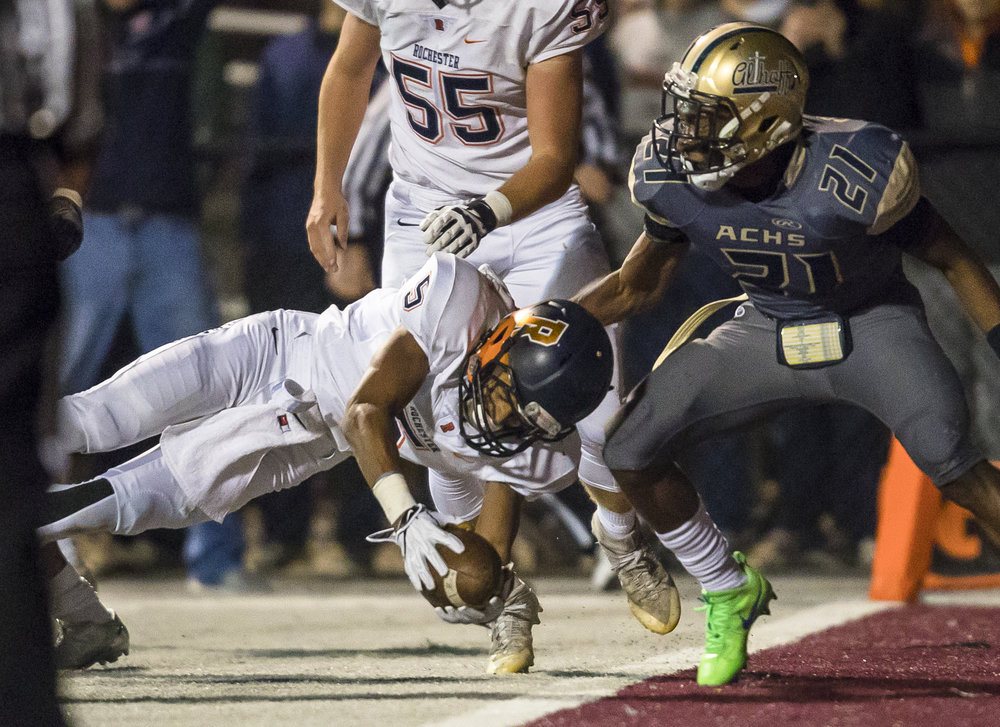 Rochester's Avante' Cox (5) dives for the end zone for a touchdown against Belleville Althoff's CJ Coldon (21) in the first half of a IHSA Class 4A quarterfinal playoff game at Lindenwood Stadium, Saturday, Nov. 12, 2016, in Belleville, Ill. Justin L. Fowler/The State Journal-Register